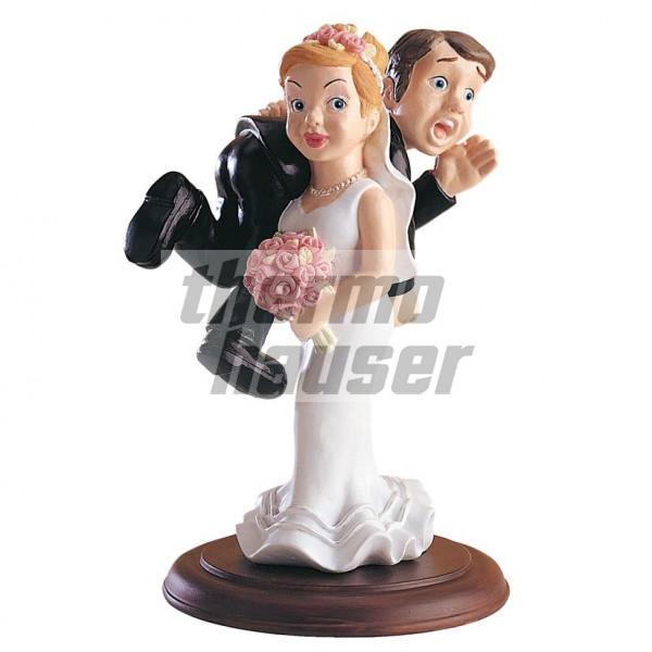 Tortenfigur Braut wirft Bräutigam über die Schulter